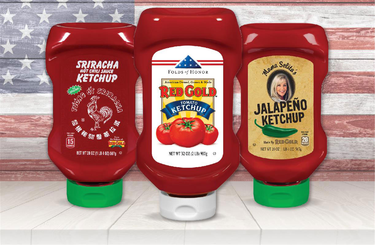 Image of Red Gold ketchup flavors Sriracha, Folds of Honor and Mama Selita Jalapeno ketchup with american flag background